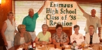 Classmates and spouses/guests pose for picture with Reunion banner at the Hillstone Restaurant in Emmaus.